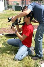 Student Kneeling Using Steadicam